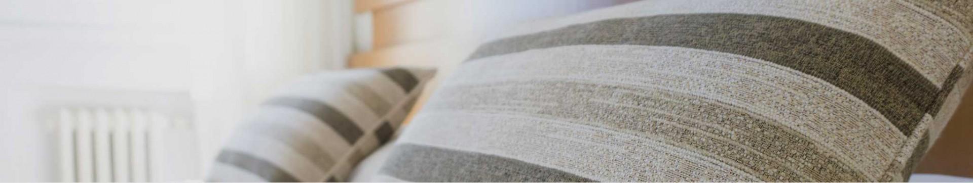 I cuscini eleganti e moderni delle nostre camere da letto